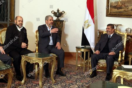 Egyptian President Mohamed Morsi (r) Meets with Palestinian Hamas Leader Khaled Meshaal (c) and Hamas Member Moussa Abu Marzouk (l) at the Presidential Palace in Cairo Egypt 09 January 2013 According to Media Reports Egyptian President Mohamed Morsi Will on 09 January Meet President Mahmoud Abbas of the Fatah Party and Hamas Leader Khaled Meshaal to Push Unity Talks Between the Rival Palestinian Groups Egypt Cairo