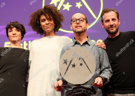 French Director and Actor Maurice Barthelemy Holds the Jury Prize He Received For His Film 'Pas Tres Normal Activites' with (l-r) Florence Foresti Stefi Celma and Fred Testot During the Closing Ceremony of the 16th Annual International Comedy Film Festival in L'alpe D'huez France 19 January 2013 France Alpe D'huez