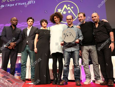 French Director and Actor Maurice Barthelemy (3-r) Holds the Jury Prize He Received For His Film 'Pas Tres Normal Activites' with (l-r) Lucien Jean-baptiste Raphael Personnaz Florence Foresti Stefi Celma Fred Testot and Jerome Commandeur During the Closing Ceremony of the 16th Annual International Comedy Film Festival in L'alpe D'huez France 19 January 2013 France Alpe D'huez