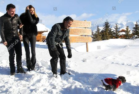 (l-r) French Actors Michael Youn Isabelle Funaro and Jose Garcia Play with a Dog As They Pose During a Photocall For the Movie 'Vive La France' at the 16th Annual International Comedy Film Festival in L'alpe D'huez France 17 January 2013 the Movie is Presented out of Competition at the Festival That Runs From 16 to 20 January France Alpe D'huez