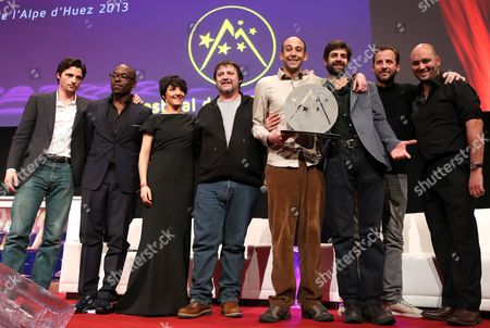 Raphael Personnaz Lucien Jean-baptiste Florence Foresti Guy Lecluyse Charles Henry Simon Masnay Fred Testot and Jerome Commandeur Pose with the Short Film Prize During the Closing Ceremony of the 16th Annual International Comedy Film Festival in L'alpe D'huez France 19 January 2013 France Alpe D'huez