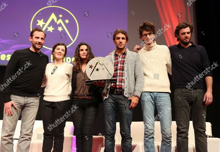 French Director Ruben Alves Holds the Public Prize He Received For His Film 'La Cage Doree' with (l-r) Fred Testot Laetitia Galitzine Barbara Cabrita Hugo Gelin and Lannick Gautry During the Closing Ceremony of the 16th Annual International Comedy Film Festival in L'alpe D'huez France 19 January 2013 France Alpe D'huez