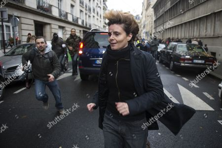 Stock Picture of French Journalist and Film Maker Caroline Fourest is Chased by People who Joined the Protest Organized by French Catholic Radicals Against Gay Marriage who Are Pursuing Femen Activists Counter Protesters and Journalists During the Anti-gay Marriage Rally in Paris France 18 November 2012 the Catholic Church and Some Conservative Politicians Have Come out Against the Government Plan For Gay Marriage and Adoptions by Homosexual Couples Due to Go Before the National Assembly in January Femen Activists Are Internationally Known For Organizing Topless Protests Against Sex Tourism Religious Institutions International Marriage Agencies Sexism and Other Social Issues France Paris
