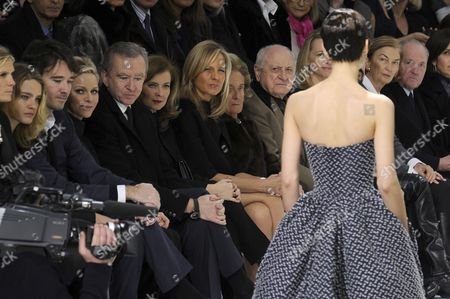 (l-r) Russian Model Natalia Vodianova Administrator of the Lvmh Group Antoine Arnault Princess Charlene of Monaco Owner of Lvmh Group Bernard Arnault Partner of French President Francois Hollande Valerie Trierweiler Piano Player Helene Mercier Arnault Former French Lady Bernadette Chirac and Pierre Berge Attend the Presentation of the Haute Couture Spring-summer 2013 Collection of Christian Dior by Belgian Designer Raf Simons During the Paris Fashion Week in Paris France 21 January 2013 the Presentation of the Haute Couture Collections Runs From 21 to 24 January France Paris