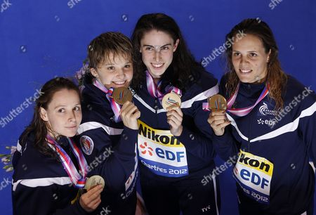 (l-r) Fanny Babou Melanie Henique Anna Santamans and Laure Manaudou of France Celebrate with Their Medals After Placing Third in the Women's 4x50m Medley Relay Final During the European Short Course Swimming Championships in Chartres France 25 November 2012 France Chartres