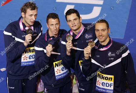 (l-r) Amaury Leveaux Frederick Bousquet Florent Manaudou and Jeremy Stravius of France Celebrate with Their Medals After Winning the Men's 4x50m Freestyle Final During the European Short Course Swimming Championships in Chartres France 25 November 2012 France Chartres