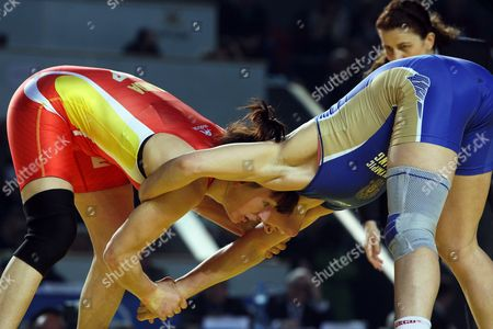 Natalia Vorobeva (blue) of Russia in Action Against Maider Unda Gonzalez De Audicana (red) of Spain During Their Women's 72kg Category Gold Medal Bout at the European Wrestling Championships in Tbilisi Georgia 22 March 2013 Georgia Tbilisi