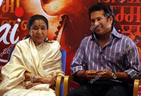 Indian Legendary Playback Singer Asha Bhosle (l) and Indian Cricketer Sachin Tendulkar (r) Pose For Photographs As They Attend the Release of the Movie 'Mai' (mother) in Mumbai India 22 January 2013 Bollywood Playback Singer Asha Bhosle 70 Makes Her Debut in Acting in the Movie 'Mai' She Sung Over 12 000 Songs For Over 800 Movies and Given Her Voice in Many Languages (including Assames Urdu Telugu Marathi Bengali Gujarati Punjabi Tamil English and Many More) India Mumbai
