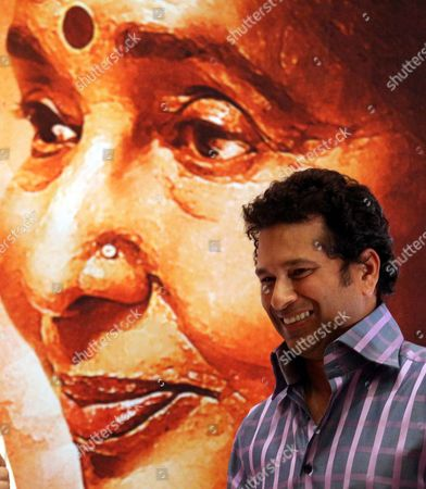 Indian Cricketer Sachin Tendulkar (r) Attends the Release of the Movie 'Mai' (mother) in Mumbai India 22 January 2013 Bollywood Playback Singer Asha Bhosle 70 Makes Her Debut in Acting in the Movie 'Mai' She Sung Over 12 000 Songs For Over 800 Movies and Given Her Voice in Many Languages (including Assames Urdu Telugu Marathi Bengali Gujarati Punjabi Tamil English and Many More) India Mumbai