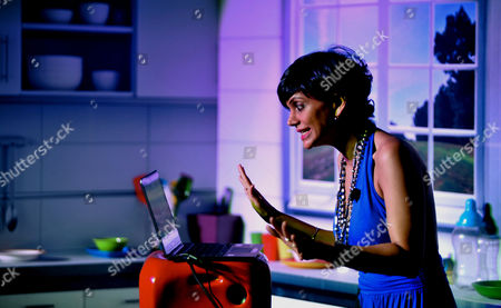 Bollywood Actress Mandira Bedi Tries out a Windows 8 Microsoft Surface at a Promotional Event For the New Device During the Launch of the Windows 8 Operating System in Bangalore India 31 October 2012 Windows 8 is Designed to Work Across Form Factors and Platforms (such As Tablets) ' and It Has Partnered with 14 Manufacturers Including Dell Lenovo Hp Hcl Acer Asus who Together Would Put on Sale 250 Devices Running on the Latest Windows Os (operating System) and These Decives Would Be Available in Across 2 500 Stores in Over 100 Cities in India India Bangalore
