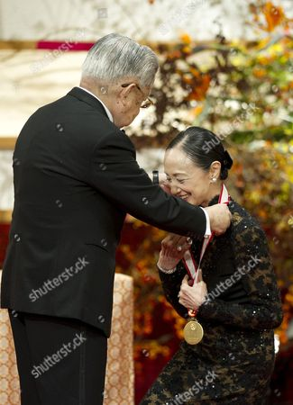 Japanese Prince Hitachi (l) Presents a Gold Medal to Japanese Ballet Dancer Yoko Morishita During the Praemium Imperiale Awards Ceremony in Tokyo Japan 23 October 2012 the Award is Presented Annually by the Japan Art Association For Painting Architecture Sculpture Music and Theater/film Japan Tokyo