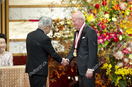Japanese Prince Hitachi (l) Shakes Hands with Italian Sculptor Cecco Bonanotte During the Praemium Imperiale Awards Ceremony in Tokyo Japan 23 October 2012 the Award is Presented Annually by the Japan Art Association For Painting Architecture Sculpture Music and Theater/film Japan Tokyo
