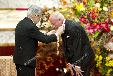 Japanese Prince Hitachi (l) Presents a Gold Medal to Italian Sculptor Cecco Bonanotte During the Praemium Imperiale Awards Ceremony in Tokyo Japan 23 October 2012 the Award is Presented Annually by the Japan Art Association For Painting Architecture Sculpture Music and Theater/film Japan Tokyo