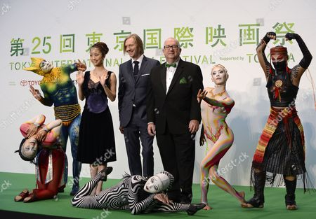 New Zealand's Film Director Andrew Adamson (c) Poses with Executive Producer Jacques Methe (r) Japanese Actress Aya Ueto (l) and Performers of the Cirque Du Soleil During the Opening Event of the 25th Tokyo International Film Festival (tiff) in Tokyo Japan 20 October 2012 'Cirque Du Soleil: Worlds Away' is the Official Opening Movie of the Festival the Tiff Will Present a Large Selection of Movies Until 28 October Japan Tokyo