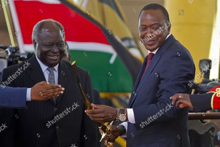 Kenya's Fourth President Uhuru Kenyatta (r) is Given a Symbolic Sword by Outgoing President Mwai Kibaki (l) During His Inauguration Ceremony in Kasarani Outskirts of the Capital Nairobi Kenya 09 April 2013 Kenyatta was Sworn in As the Country's Fourth President on 09 April at a Stadium Filled with Tens of Thousands of Cheering Supporters Despite the Charges He Faces at the International Criminal Court (icc) For the Crimes Against Humanity Kenya Nairobi