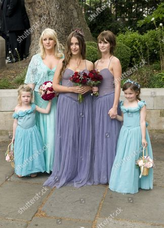 Maid of honour, Amanda Harrington with bridesmaids Domino Kirke and Kirsty Taylor, also flower girls (front row ) Kitty and Mercy Magic