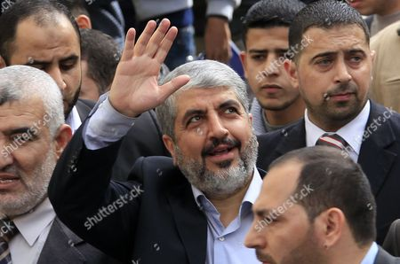 Exiled Hamas Leader Khaled Meshaal (c) Waves to Palestinian Students During His Visit to the Islamic University in Gaza City on 09 December 2012 - Gaza Strip