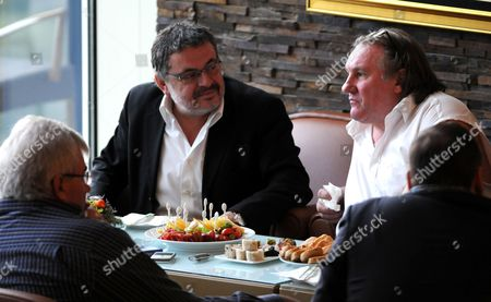 Stock Image of French Actor Gerard Depardieu (r) Talks with Montenegro Minister of Culture Branislav Micunovic (l) at the Luxurious Hotel Splendid Near Budva on the Adriatic Coast of Montenegro 08 January 2013 Depardieu Spurned a Paris Drunk Driving Court Appearance on 08 January and Went to Montenegro to Prepare a Film in Which the French Star Will Play Dominique Strauss-kahn Serbia and Montenegro Podgorica