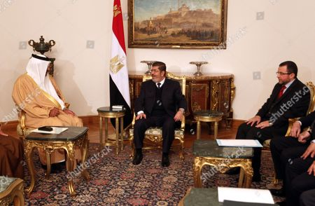 Egyptian President Mohamed Morsi (c) Meets with Qatari Prime Minister Hamad Bin Jasim Bin Jabir Al Thani (l) with the Presence of Egyptian Prime Minister Hisham Qandil (r) at the Presidential Palace in Cairo Egypt 08 January 2013 According to Media Reports on 08 January Qatar Confirmed It Would Lend Egypt's Government an Additional 2 Billion Dollars and Grant It an Extra 500 Million Dollars Outright Extending a Lifeline As the Government Battles to Contain a Currency Crisis Egypt Cairo