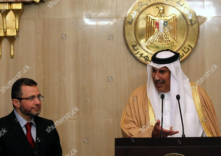 Qatari Prime Minister Hamad Bin Jasim Bin Jabir Al Thani (r) Speaks During a Joint Press Conference with Egyptian Prime Minister Hisham Qandil (l) at the Presidential Palace in Cairo Egypt 08 January 2013 According to Media Reports on 08 January Qatar Confirmed It Would Lend Egypt's Government an Additional 2 Billion Dollars and Grant It an Extra 500 Million Dollars Outright Extending a Lifeline As the Government Battles to Contain a Currency Crisis Egypt Cairo