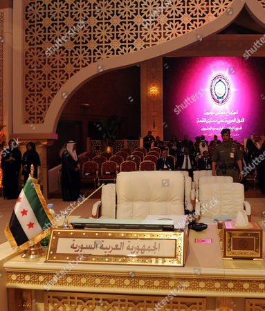 A Pre-baath Syrian Flag Currently Used by the Syrian Opposition is Seen in Front of the Seat of the Syrian Delegation at the Opening of the Arab League Summit in Doha Qatar 26 March 2013 the Syrian Opposition was on 26 March Handed Syria's Seat in the Arab League National Coalition Leader Moaz Al-khatib and a Small Delegation Were in Attendance at the Annual Summit of the 22-member Pan-arab Grouping Qatar Doha