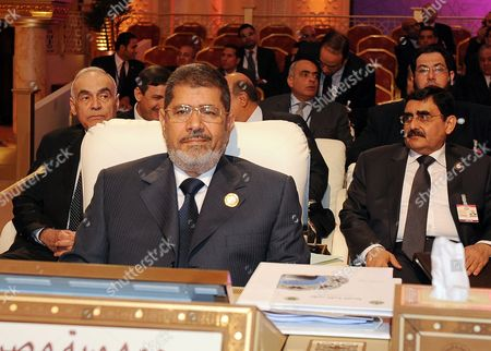 Egyptian President Mohamed Morsi Looks on During the Opening of the Arab League Summit in Doha Qatar 26 March 2013 the Syrian Opposition was on 26 March Handed Syria's Seat in the Arab League National Coalition Leader Moaz Al-khatib and a Small Delegation Were in Attendance at the Annual Summit of the 22-member Pan-arab Grouping Qatar Doha