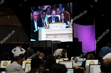 Members of the Media Watch Live in Tv Syrian National Coalition (snc) President Mouaz Al-khatib During a Live Address During the Opening of the Arab League Summit in Doha Qatar 26 March 2013 the Syrian Opposition was on 26 March Handed Syria's Seat in the Arab League National Coalition Leader Moaz Al-khatib and a Small Delegation Were in Attendance at the Annual Summit of the 22-member Pan-arab Grouping Qatar Doha