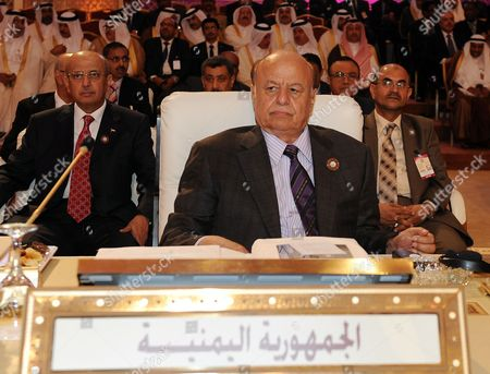 Yemeni President Abdo Rabbo Mansour Hadi Attends the Arab League Summit in Doha Qatar 26 March 2013 the Syrian Opposition was on 26 March Handed Syria's Seat in the Arab League National Coalition Leader Moaz Al-khatib and a Small Delegation Were in Attendance at the Annual Summit of the 22-member Pan-arab Grouping Qatar Doha