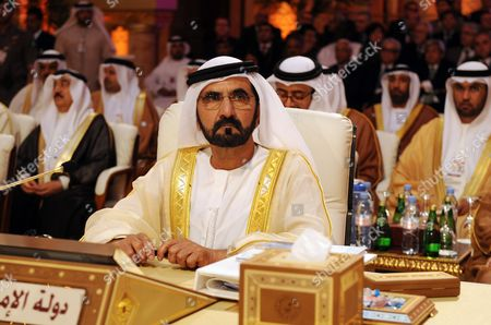 United Arab Emirates' Prime Minister and Ruler of Dubai Sheikh Mohammed Bin Rashid Al-maktoum Looks on During the Opening of the Arab League Summit in Doha Qatar 26 March 2013 the Syrian Opposition was on 26 March Handed Syria's Seat in the Arab League National Coalition Leader Moaz Al-khatib and a Small Delegation Were in Attendance at the Annual Summit of the 22-member Pan-arab Grouping Qatar Doha