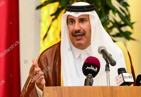 Stock Image of Qatari Prime Minister Sheikh Hamad Bin Jassim Al-thani Speaks During a Press Conference with Egyptian Prime Minister Hisham Qandil (not Pictured) at the Emiri Diwan in Doha Qatar 10 April 2013 According to Media Sources Qatar on 10 April Agreed to Allocate Three Billion Dollars to Buy Egyptian Bonds to Help the Egyptian Economy Qatar Doha