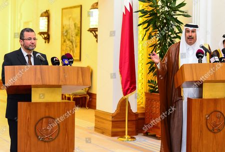 Egyptian Prime Minister Hisham Qandil (l) Listens to Qatari Prime Minister Sheikh Hamad Bin Jassim Al-thani (r) During a Joint News Conference at the Emiri Diwan in Doha Qatar 10 April 2013 According to Media Sources Qatar on 10 April Agreed to Allocate Three Billion Dollars to Buy Egyptian Bonds to Help the Egyptian Economy Qatar Doha