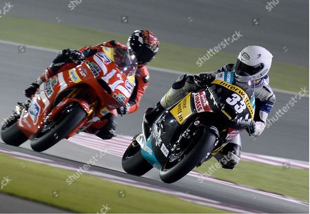 Spanish Moto2 Rider Sergio Gadea (r) of the Interwetten Paddock Team in Action During a Free Practice Session Second Day For the Motorcycling Grand Prix of Qatar at Al Losail International Circuit in Doha Qatar 05 April 2013 the 2013 Motogp World Championship Season's First Race Will Be Held at Losail International Circuit on 07 April 2013 Qatar Doha