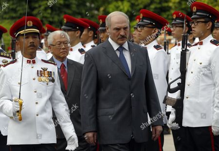 The President of Belarus Aleksandr Lukashenko (c) Reviews an Honor Guard During a Welcome Ceremony at the Istana the Presidential Palace in Singapore 21 March 2013 President Lukashenko is on a Two-day Official State Visit to Singapore Singapore Singapore