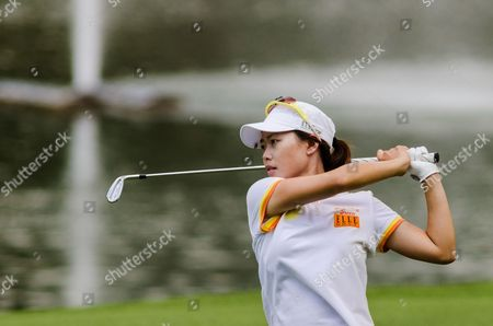 Sun Young Yoo of South Korea Watches Her Shot on the 9th Hole During Round Two of the Hsbc Women's Champions Golf Tournament in Singapore 01 March 2013 the Sixth Edition of the Hsbc Women's Champions Takes Place at the Serapong Course of the Sentosa Golf Club (sgc) For the First Time in History Singapore Singapore
