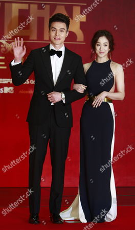 South Korean Actors Lee Dong-wook (l) and Jung Rye-won (r) Arrive For the 2012 Annual Sbs Drama Awards at the Sbs Prism Tower in Seoul South Korea 31 December 2012 the Sbs Drama Awards Ceremony Honors Actors and Actresses who Have Stared in Dramas by Sbs the Awards Started in 1993 and Have Been Held Annually Ever Since Korea, Republic of Seoul