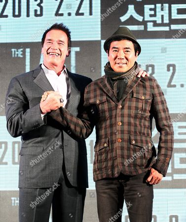 Former Governor of California and Us Actor Arnold Schwarzenegger (l) Shakes Hands with South Korean Director Kim Jee-woon (r) Prior a Press Conference on Their Film 'The Last Stand' at a Hotel in Seoul South Korea 20 February 2013 the Movie Will Open in South Korean Theaters on 21 February Korea, Republic of Seoul