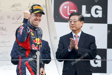 Winner German Formula One Driver Sebastian Vettel (l) of Red Bull Racing Celebrates As He Walks Past South Korean Prime Minister Kim Hwang Sik at the End of the South Korea Formula One Grand Prix at the Korean International Circuit in Yeongam South Korea 14 October 2012 Korea, Republic of Yeongam