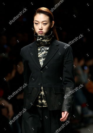 Stock Picture of A Model Presents a Creation by South Korean Designer Song Zio During the 2013 Fall/winter Seoul Fashion Week in Seoul South Korea 25 March 2013 Some 70 Designers Showcase Their Collections During the Event That Runs From 25 to 30 March Korea, Republic of Seoul