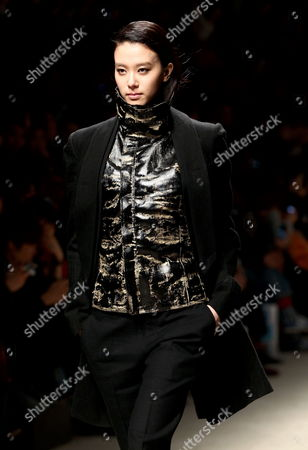 Stock Photo of A Model Presents a Creation by South Korean Designer Song Zio During the 2013 Fall/winter Seoul Fashion Week in Seoul South Korea 25 March 2013 Some 70 Designers Showcase Their Collections During the Event That Runs From 25 to 30 March Korea, Republic of Seoul