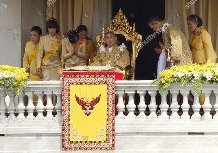Thai King Bhumibol Adulyadej (c) is Greeted by His Royal Family Members (l-r) Princess Soamsawali Mahidol His Older Daughter Princess Ubol Ratana Youngest Daughter Princess Chulabhorn Mahidol Princess Siribhachudabhorn Royal Consort Princess Srirasm Grandson Prince Dipangkorn Rasmijoti His Son Crown Prince Maha Vajiralongkorn and His Daughter Princess Maha Chakri Sirindhorn During a Public Appearance During His 85th Birthday Celebrations on the Balcony of Ananta Samakhom Throne Hall in Bangkok Thailand 05 December 2012 Hundreds of Thousands of Thais Lined the Streets of Bangkok and Crowded Into the City's Royal Plaza to Pay Tribute to King Bhumibol Adulyadej on His 85th Birthday King Bhumibol the World's Longest-reigning Monarch was Hospitalized in September 2009 and Has Since Taken Up Permanent Residence at the Siriraj Hospital in Bangkok As He is Suffering From a Variety of Ailments Thailand Bangkok
