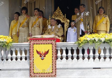 Thai King Bhumibol Adulyadej (c) Sits Next to His Family Members (l-r) Princess Soamsawali Mahidol His Older Daughter Princess Ubol Ratana Youngest Daughter Princess Chulabhorn Mahidol Princess Siribhachudabhorn Royal Consort Princess Srirasm Grandson Prince Dipangkorn Rasmijoti His Son Crown Prince Maha Vajiralongkorn and His Daughter Princess Maha Chakri Sirindhorn During a Public Appearance to Mark His 85th Birthday Celebrations on the Balcony of Ananta Samakhom Throne Hall in Bangkok Thailand 05 December 2012 Hundreds of Thousands of Thais Lined the Streets of Bangkok and Crowded Into the City's Royal Plaza to Pay Tribute to King Bhumibol Adulyadej on His 85th Birthday King Bhumibol the World's Longest-reigning Monarch was Hospitalized in September 2009 and Has Since Taken Up Permanent Residence at the Siriraj Hospital in Bangkok As He is Suffering From a Variety of Ailments Thailand Bangkok