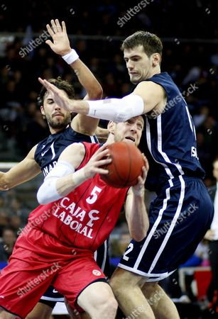 Caja Laboral's Andres Nocioni (c) in Action Against Anadolu Efes' Sasha Vujacic (l) and Stanko Barac (r) During Their Euroleague Group C Basketball Match in Istanbul Turkey 07 December 2012 Turkey Istanbul