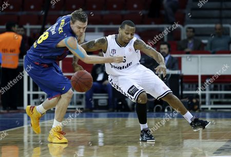 Barcelona Regal's C J Wallace (l) Challenges For Ball Against Besiktas Istanbul's Curtis Jerrels During Their Euroleague Top 16 Group F Basketball Match in Istanbul Turkey 17 January 2013 Turkey Istanbul