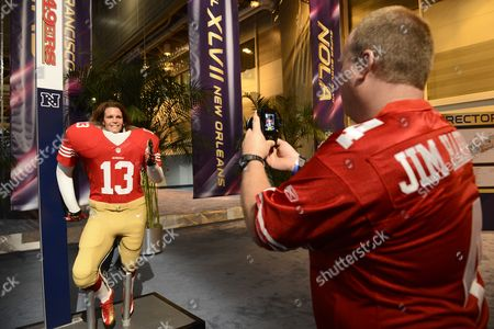 Julie Roberts (l) of North Carolina Poses For Her Husband Kevin Roberts (r) in a San Francisco 49ers Player Uniform at the Nfl Experience in New Orleans Louisiana Usa 30 January 2013 the Afc Champion Baltimore Ravens Will Play the Nfc Champion San Francisco 49ers in Super Bowl Xlvii on 03 February 2013 United States New Orleans