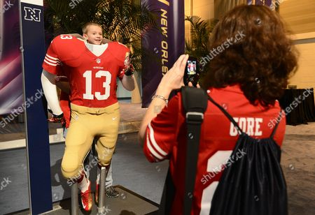 Five-years-old Jay Roberts (l) of North Carolina Poses For His Mother Julie Roberts (r) in a San Francisco 49ers Player Uniform at the Nfl Experience in New Orleans Louisiana Usa 30 January 2013 the Afc Champion Baltimore Ravens Will Play the Nfc Champion San Francisco 49ers in Super Bowl Xlvii on 03 February 2013 United States New Orleans