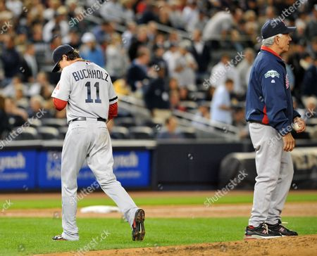 Boston Red Sox Starting Pitcher Clay Buchholz (l) is Seen Walking Off the Field After Being Taken out of the Ball Game by Manager Bobby Valentine in the Second Inning Against the the New York Yankees at Yankees Stadium in the Bronx New York Usa 01 October 2012 United States Bronx