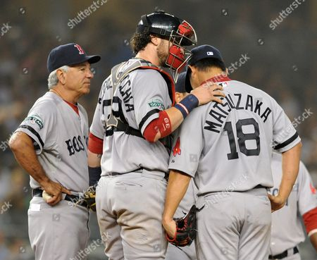Boston Red Sox Catcher Jarrod Saltalmacchia (c) Consoles Starting Pitcher Daisuke Matsuzaka (c-r) and Manager Bobby Valentine (l) Takes Him out of the Ball Game in the Third Inning at Yankees Stadium in the Bronx New York Usa 03 October 2012 United States Bronx