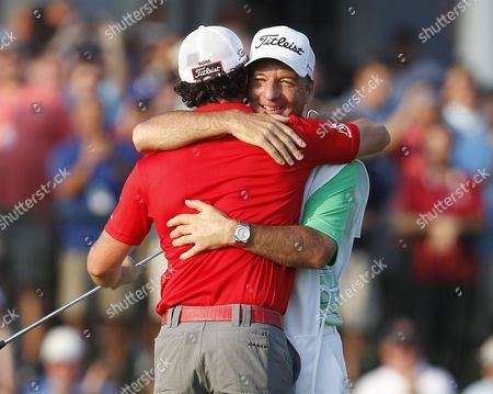 Rory Mcilroy of Northern Ireland (l) Celebrates with His Caddie J P Fitzgerald (r) After Winning the Pga Championship at the Ocean Course at Kiawah Island South Carolina Usa 12 August 2012 United States Kiawah Island