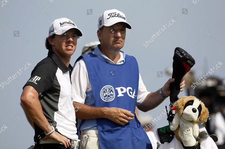 Rory Mcilroy of Ireland (l) and His Caddie J P Fitzgerald (r) Look Down the Fairway on the Ninth Hole During the Third Day of the Pga Championship on the Ocean Course at Kiawah Island South Carolina Usa 11 August 2012 United States Kiawah Island