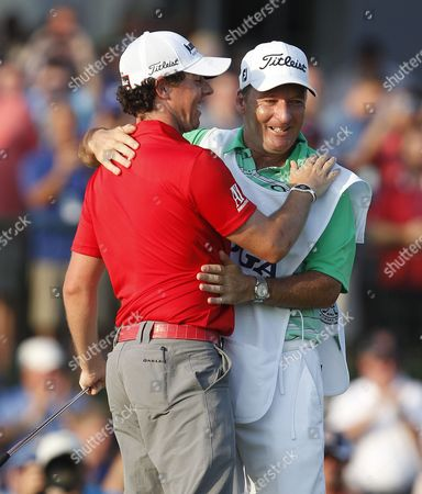 Rory Mcilroy of Northern Ireland (l) Celebrates with His Caddie J P Fitzgerald (l) After Winning the Pga Championship at the Ocean Course at Kiawah Island South Carolina Usa 12 August 2012 United States Kiawah Island